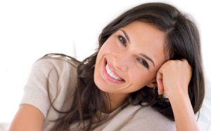 Woman with a beautiful smile thanks to her Invisalign dentist in reichardson